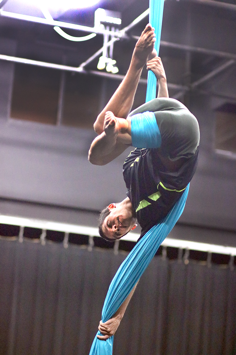Renzo Jimenez performs an aerial routine in the studio, March 26.